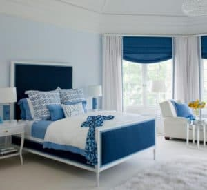 awesome-bedroom-design-with-blue-tones-also-white-furry-rug-and-chair-beside-window-768x706