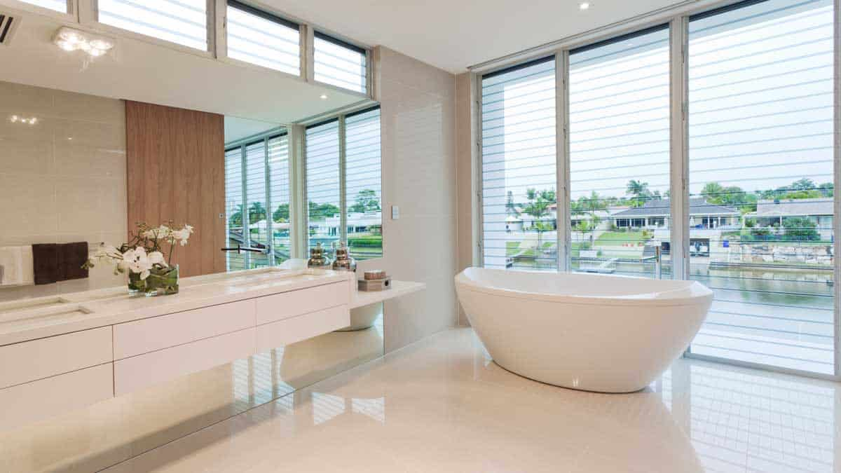 luxury bathroom with large window treatments