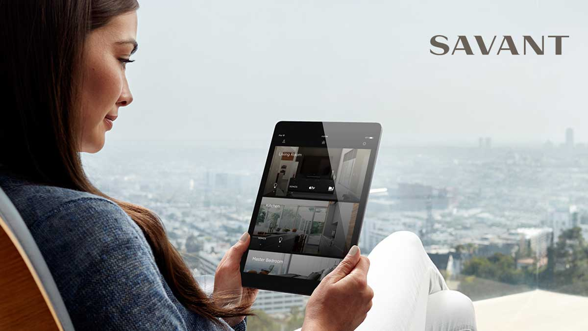 lady holding tablet with savant system