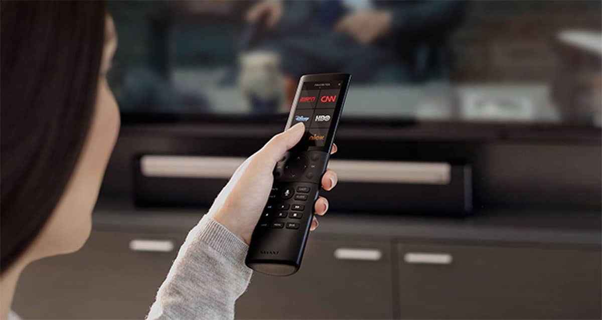 woman holding savant home theater smart remote