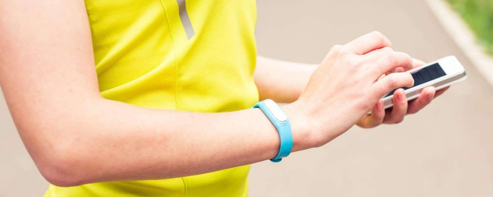 Hand wearing a fitness tracking armband