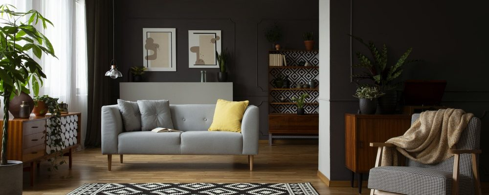 Real photo of open space dark living room interior with molding